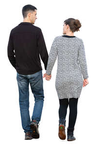 couple walking hand in hand on a shady day