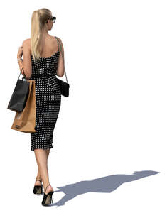 woman with shopping bags walking in sunlight