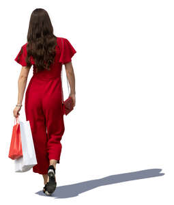 woman in a red jumpsuit walking shopping bags in hand