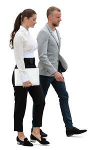 businessman and businesswoman walking side by side