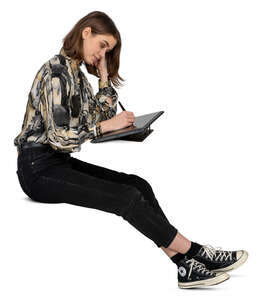 woman sitting and drawing on a graphics tablet