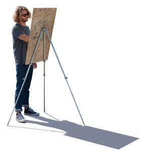 young man standing and drawing