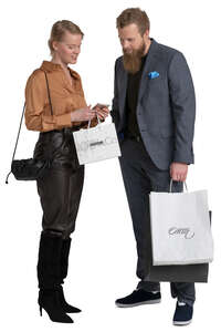 man and woman with shopping bags standing and discussing smth
