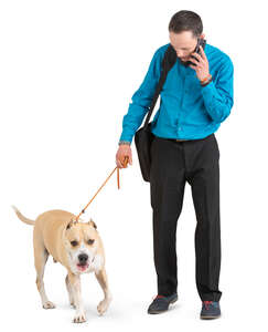 man with a dog standing and talking on a phone