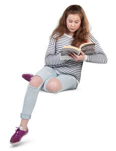 teenage girl sitting and reading a book