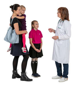 woman with two kids talking to a doctor