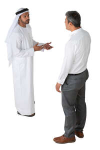 arab man talking to an european businessman seen from above