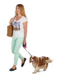 young woman with a dog walking