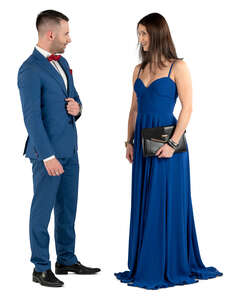 man and woman standing and talking on a formal event