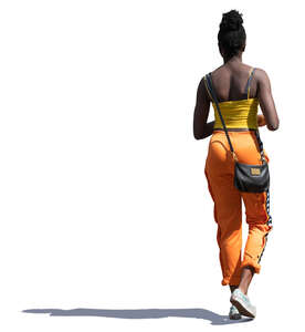 sidelit black woman walking on a summer day