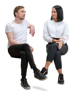 man and woman sitting and talking