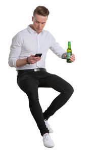 young man sitting in a bar and drinking beer