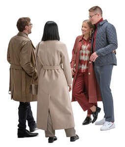 four people in overcoats standing and talking