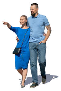 man and woman walking and pointing at smth