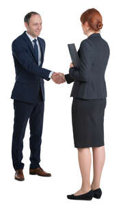 man and woman shaking hands at a business meeting