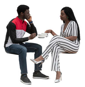 black man and woman sitting in a cafe and talking