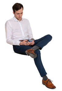 man sitting and browsing his phone