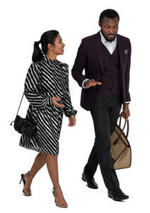 black man and indian woman walking and talking