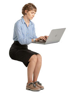 woman sitting and working on a laptop