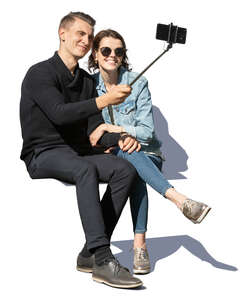 couple sitting and taking a selfie