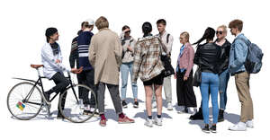 large group of teenagers standing and talking