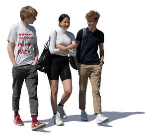 group of three young people walking