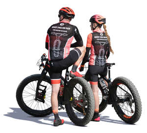 sporty man and woman with bikes standing