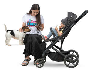 woman with a little child in a stroller sitting
