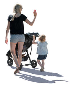 backlit image of a mother and daughter walking