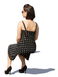 woman in a dotted summer dress sitting