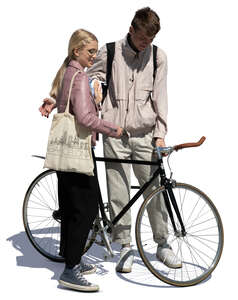 teenage boy and girl with a bike standing and talking