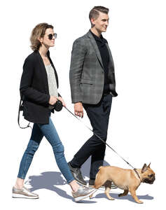 man and woman with a dog walking