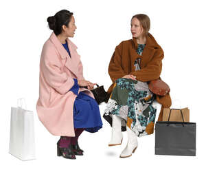 cut out two women in overcoats sitting and talking