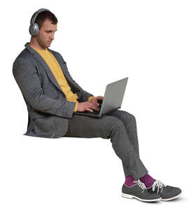 cut out man with headphones and a laptop sitting