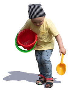 cut out little boy with a toy bucket playing