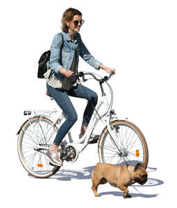 cut out woman riding a bike with a dog running beside her