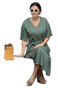 cut out woman in a green dress sitting