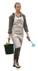 cut out woman with garden gear and apron walking