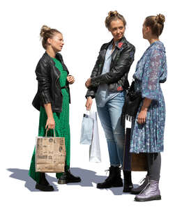 three cut out women with shopping bags standing and talking