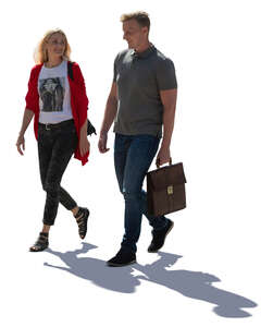 cut out backlit man and woman walking on the street and talking