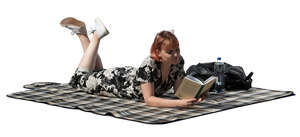 cut out young woman lying on the ground and reading a book