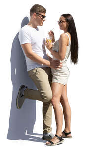 cut out couple standing and leaning against the wall
