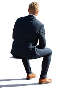 cut out backlit businessman sitting