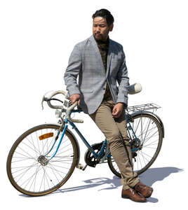 cut out japanese man standing and leaning against his bike