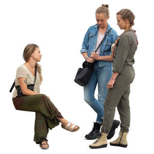 cut out woman sitting and talking to two women standing beside the bench