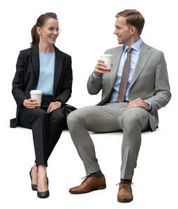 two business collegues sitting and drinking coffee