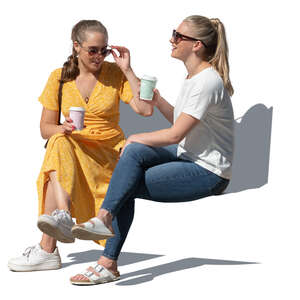 two cut out young women sitting in a park and drinking coffee