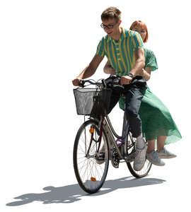 cut out young backlit couple riding a bicycle
