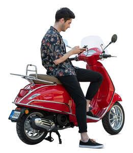 cut out man sitting on a red vespa scooter