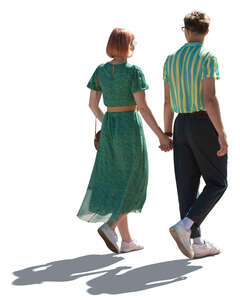 cut out young backlit couple walking hand in hand